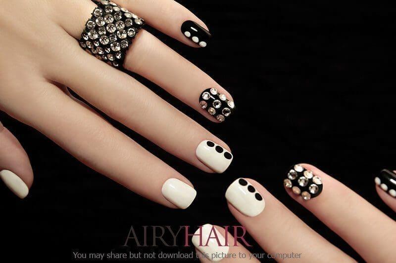 Elegant looking black and white nail art