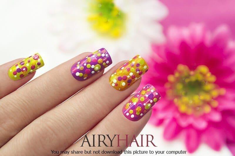 Beautiful multicoloured dots nail polish art