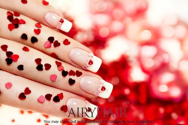 Valentine's Day special nail art design with hearts