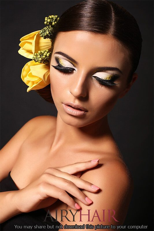 Dark brown hairstyle with yellow flowers
