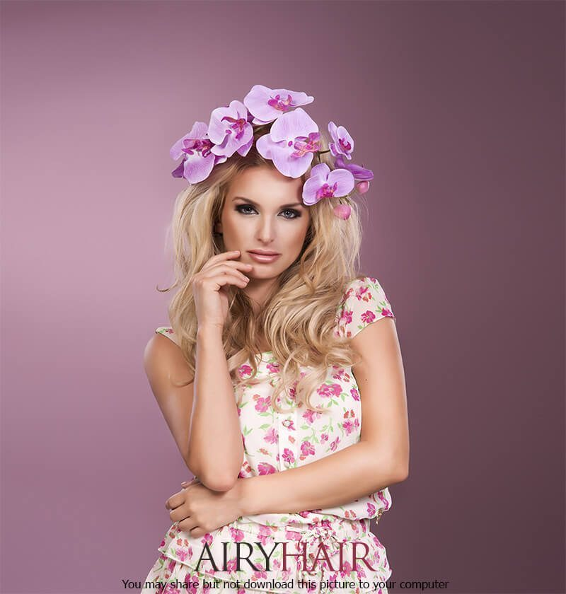 A matched pink dress & flower hairstyle