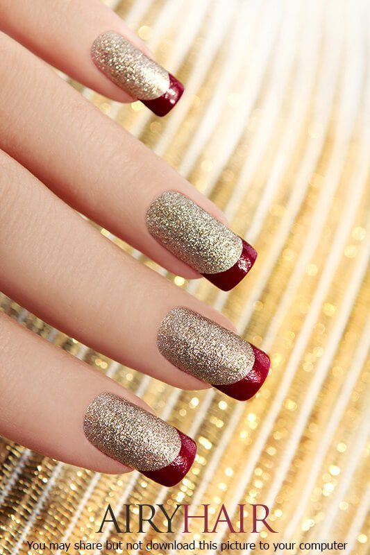 A nail design combo with ruby red polish and golden dust