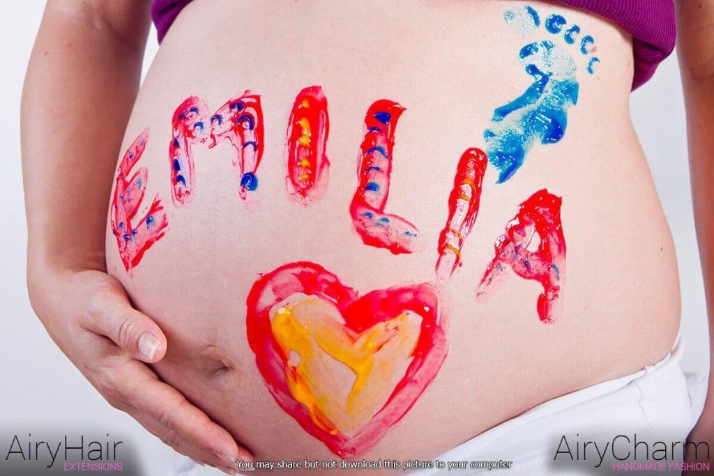Pregnant Woman Body Art: Baby Name
