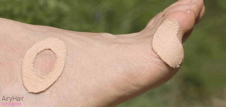 Put Moleskin on the areas that pinch your feet the most